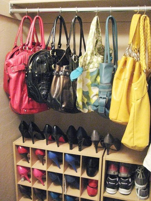 Shower hooks for purse storage ... genius! Seems more practical than shower rings since you don't have to unclasp the ring every time you want to use a purse.