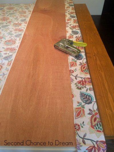Staple fabric to wood