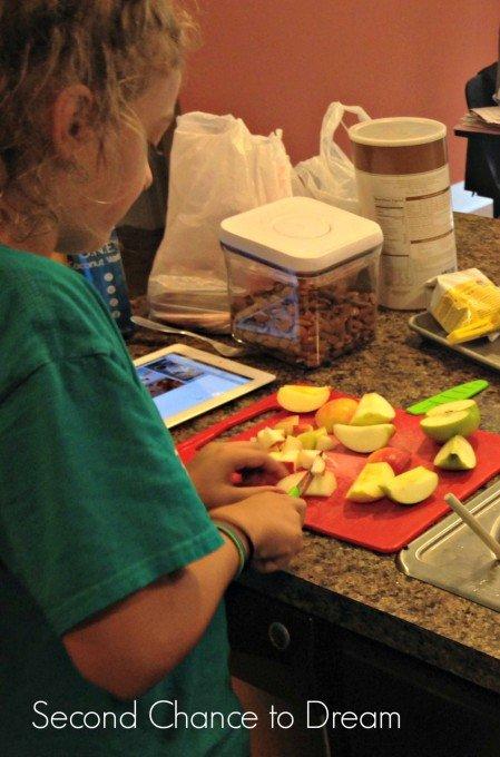 Addy cutting Apples