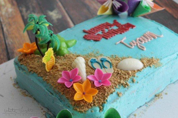 Triple Pineapple Luau Cake, a luau themed decorated cake made with pineapple cake and pineapple chunk frosting. YUM!!