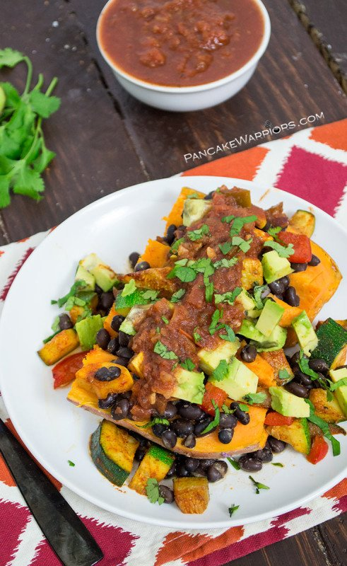 Smoky and sweet, these black bean stuffed sweet potatoes are easy to make and insanely addicting. Packed with protein and fiber, this gluten free, vegan recipe will become your new go to dinner recipe! | www.pancakewarriors.com