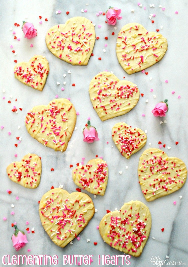 Tender and kissed with just the right touch of clementine sweetness, Clementine Butter Hearts pair with coffee, tea or chocolate. You can also use a cookie press! Recipe at littlemisscelebration.com