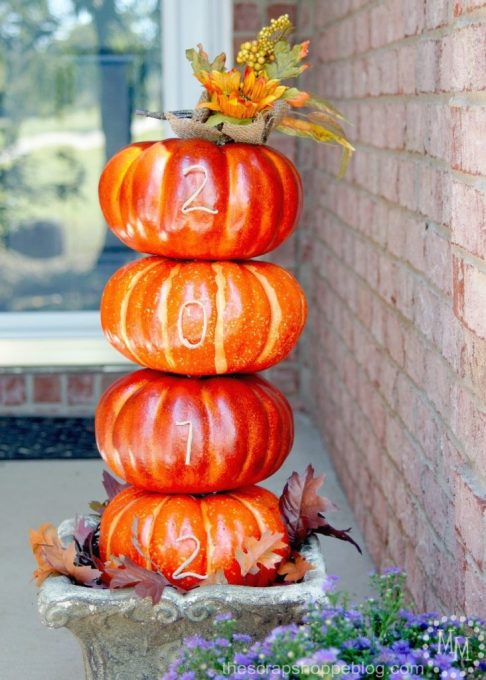 Display your house number on a DIY pumpkin topiary for a festive front porch idea!
