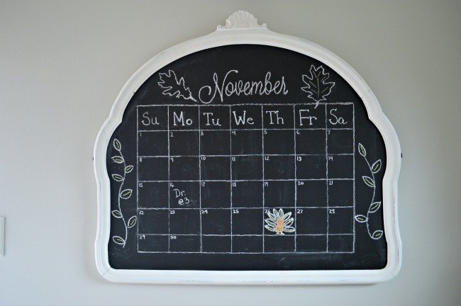Vintage mirror turned into a kitchen chalkboard with a monthly calendar | chatfieldcourt.com