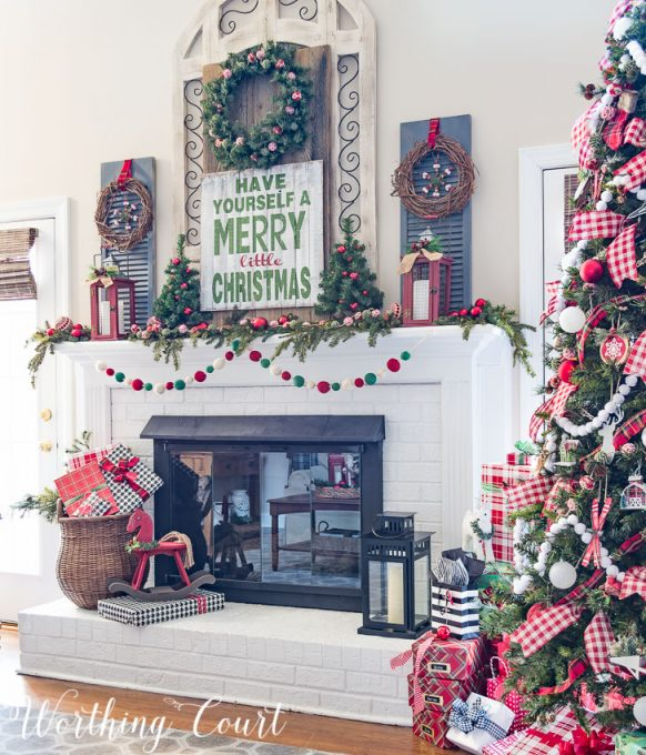 Farmhouse Christmas mantel decorated with traditional red and green    Worthing Court