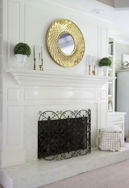 My DIY faux marble fireplace is holding up beautifully!